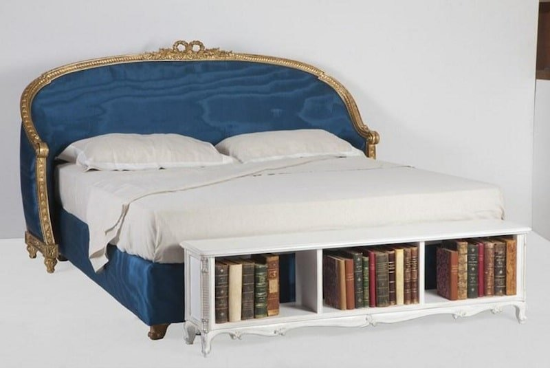 blue bed with library